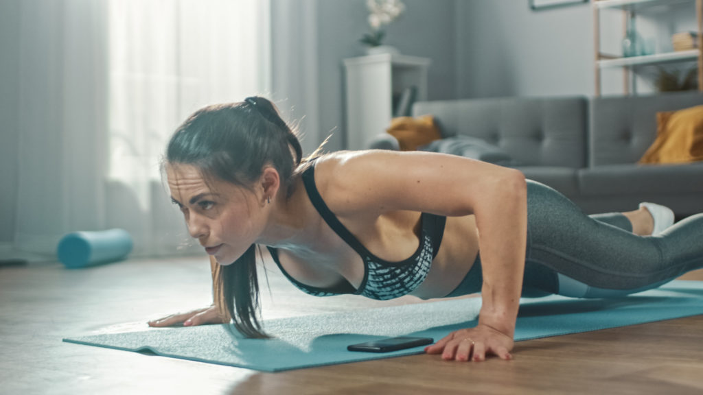 woman in push-up position