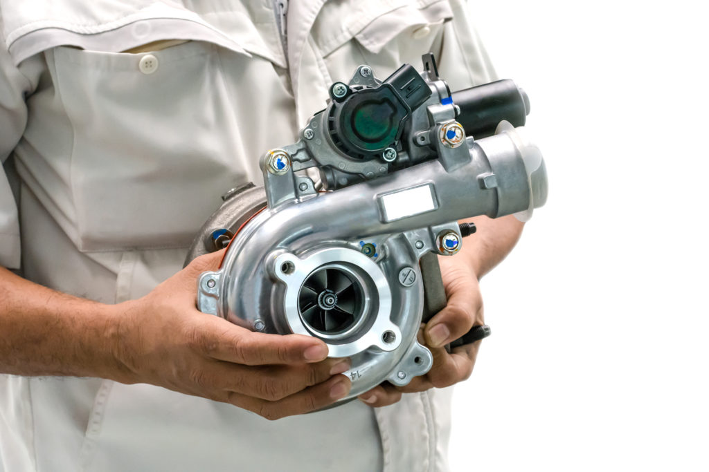 Man holding a turbocharger – beginner's guide to turbos - autoapp