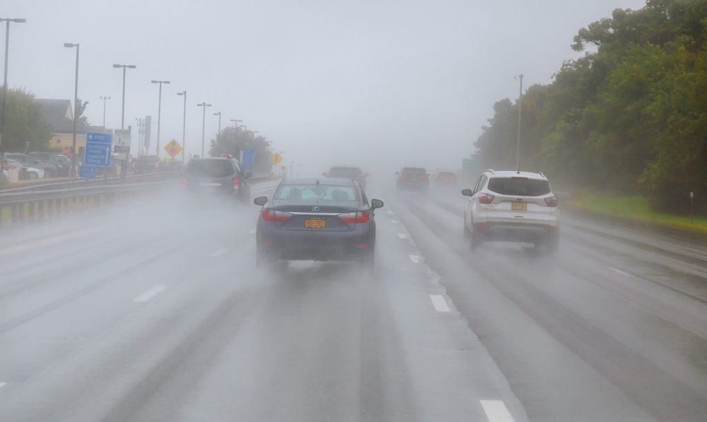 Following the grooves of the vehicle in front. Wet weather driving.