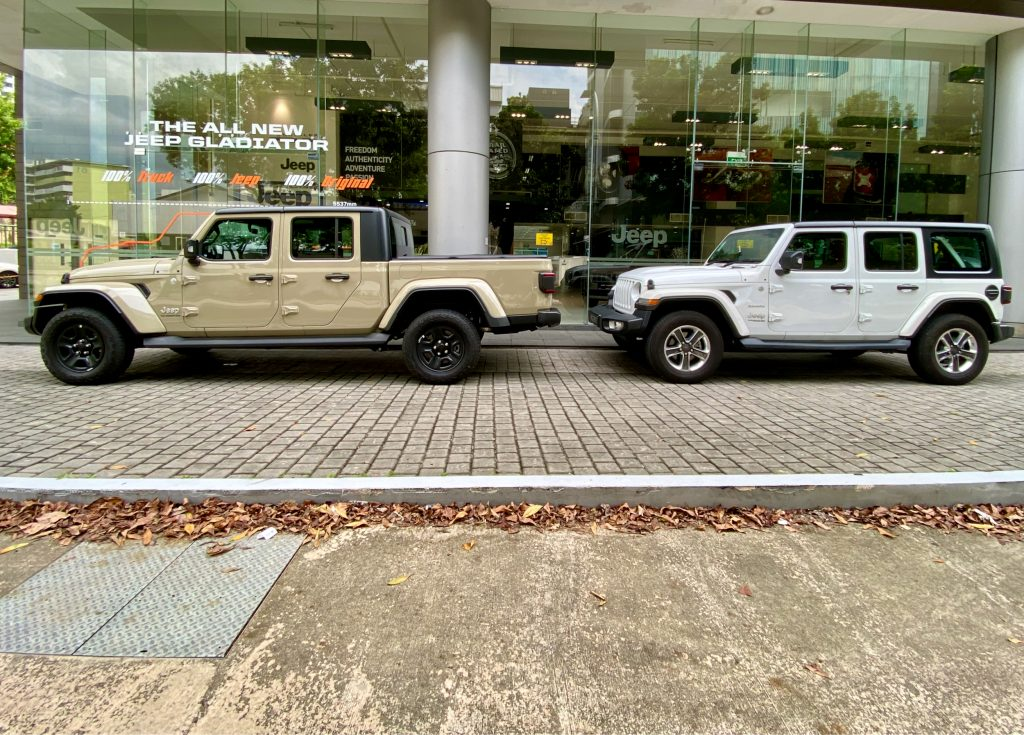 2020 Jeep Gladiator parked with a Jeep Wrangler 5-door